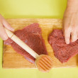 Royalty-Free Stock Photo: Cook hands making tenderized steak