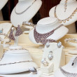 Stock Photo: Counter with jewelry in store window