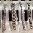 Bracelets on jewelry counter — Stock Photo