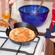 Cook hands cooking pancakes — Stock Photo
