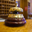 Golden bell  in hotel — Stock Photo