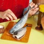 Closeup of woman is salting mackerel — Stock Photo