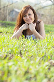 Woman relaxing in grass — Stock Photo