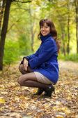 Happy woman in autumn — Stock Photo