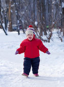 Happy toddler in winter park — Stock Photo