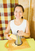 Woman grating cheese — Stock Photo