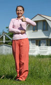 Happy woman in front of new home — Stock Photo