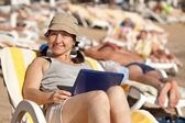Mature woman with laptop at resort — Stock Photo