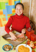Woman is stuffing red fish — Stock Photo