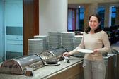 Woman at hotel buffet — Stock Photo