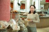 Woman takes fresh batch — Stock Photo