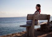 Happy mature woman near sea — Stock Photo