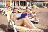 Happy mature woman with laptop at resort — Stock Photo