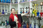 Woman chooses sheesha in shop — Stock Photo