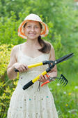 Female gardener with garden tools — Stock Photo