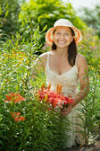 Happy woman in lily plant — Stock Photo