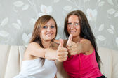 Two happy women showing thumb up — Stock Photo