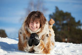Girl lying on snow — Stock Photo