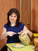 Woman with can of pickled cabbage — Stock Photo