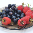 Plate with berries — Stock Photo
