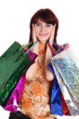 Beautiful happy woman with shopping bags isolated — Stock Photo