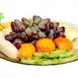 Fruit on a plate on the white background — Stock Photo