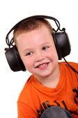 Little boy in headphones on the white background — Stock Photo