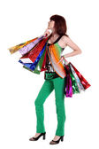Female hand holding colorful shopping bags isolated on a white b — Stock Photo