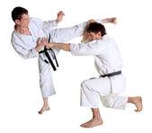 Karate. Men in a kimono with a white background — Stock Photo