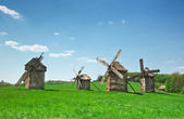 Ancient windmills in field — Stock Photo