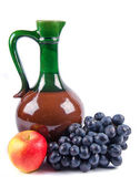 Old ceramic decanter with grapes — Stock Photo