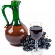 Old ceramic decanter and glass with wine — Stock Photo