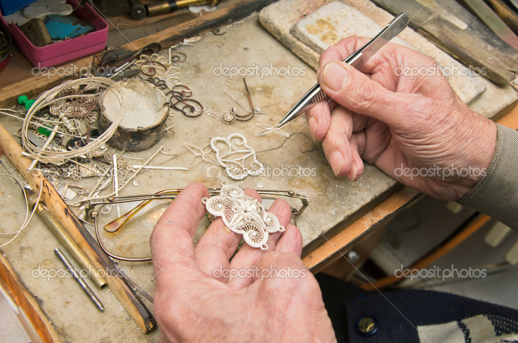 Hands of  jeweller at work  Stock Photo #8661981