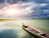 Lonely boat on lake — Stock Photo