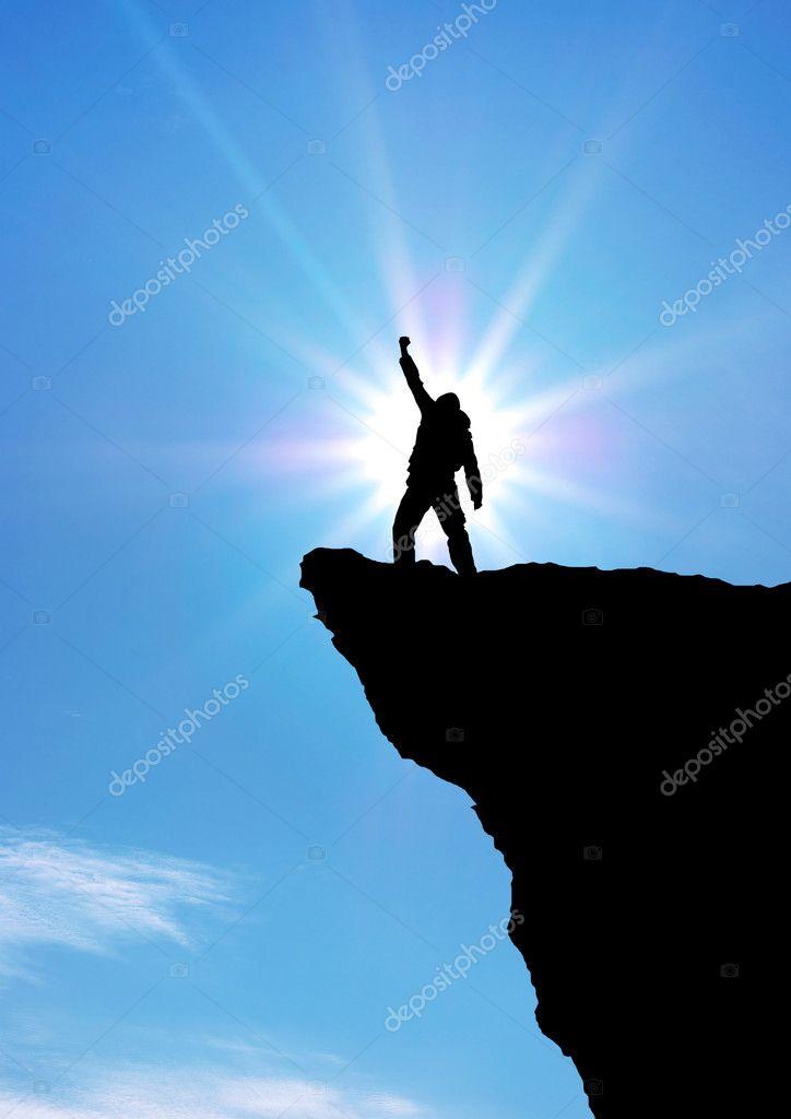 Man on top of mountain. � Stock Photo � zatvor #9842350