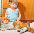 Stock Photo: Boy and cat