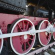 Old steam locomotive wheel and rods — Stock Photo