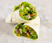 Fresh wrap sandwiches filled with ham, lettuce and pepper — Stock Photo