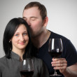 Young couple drinking glasses of red wine — Stock Photo