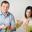 Stock Photo: Young couple preparing vegetables