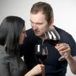 Young couple drinking glasses of red wine — Stock Photo #10248463