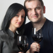 Stock Photo: Young couple drinking glasses of red wine