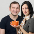 Young couple having tea together — Stock Photo