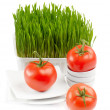 Healthy food - fresh tomato and Germinated Wheat seeds on wh — Stock Photo #10479623