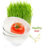 Healthy food - fresh tomato and Germinated Wheat seeds on the wh — Stock Photo