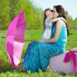 Happy mother and daughter outdoors — Foto de stock #10571686