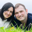 Happy young couple outdoor in spring — Stockfoto