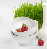 Healthy food - fresh strawberries and Germinated Wheat seeds — Stock Photo