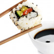 Stock Photo: Sushi on chopstick