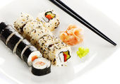 Sushi rolls, wasabi and ginger on the white plate — Stock Photo